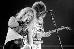 Lead singer David Lee Roth, left, and lead guitarist Eddie Van Halen of the rock group Van Halen perform during their concert at the Spectrum in Philadelphia, Pa., on Oct. 19, 1982. (AP Photo)